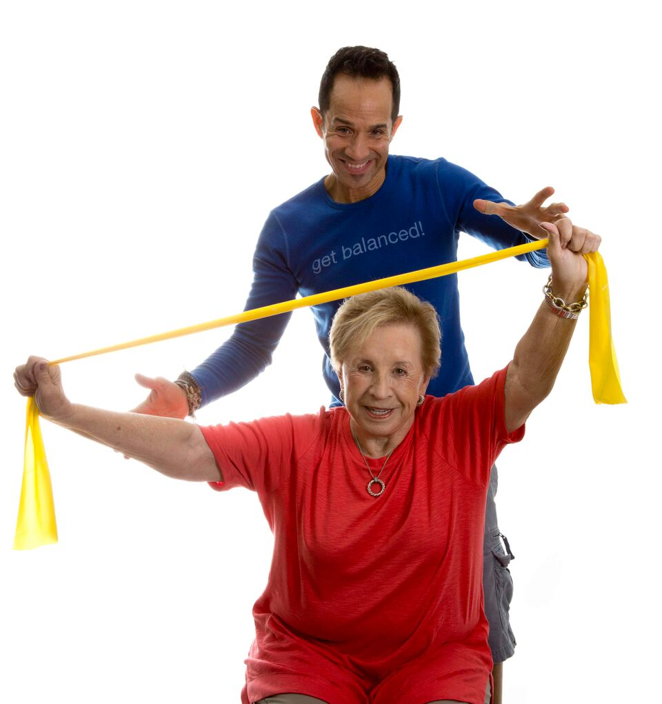 Personal trianer and client working together to meet health and fitness goals.