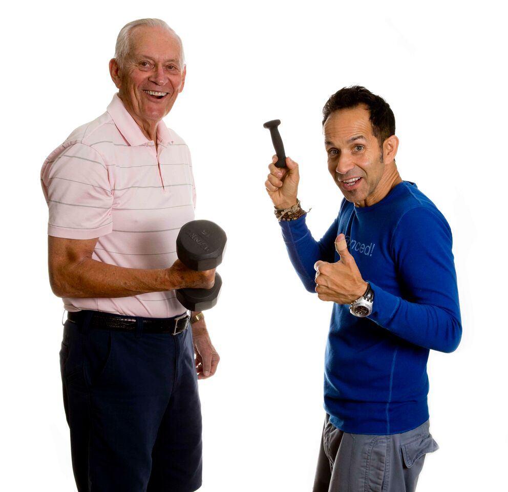 Two men working on stress reduction by working out with weights together.