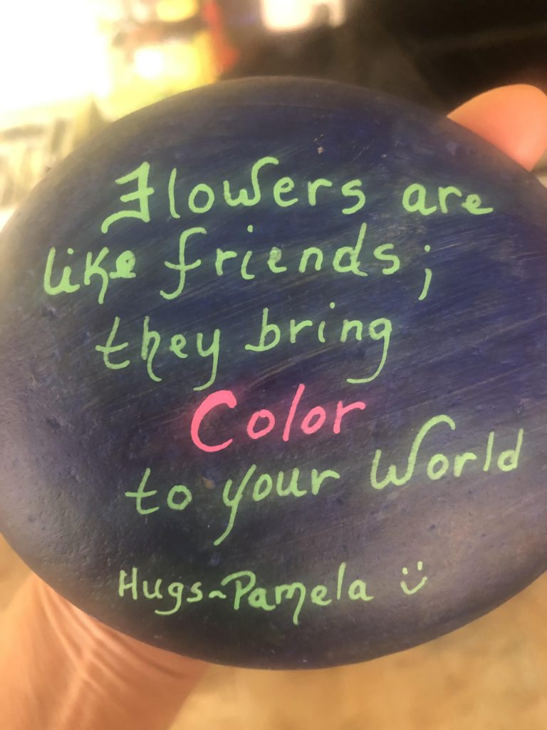 Decorative painted rock to spread joy, health, and wellness.
